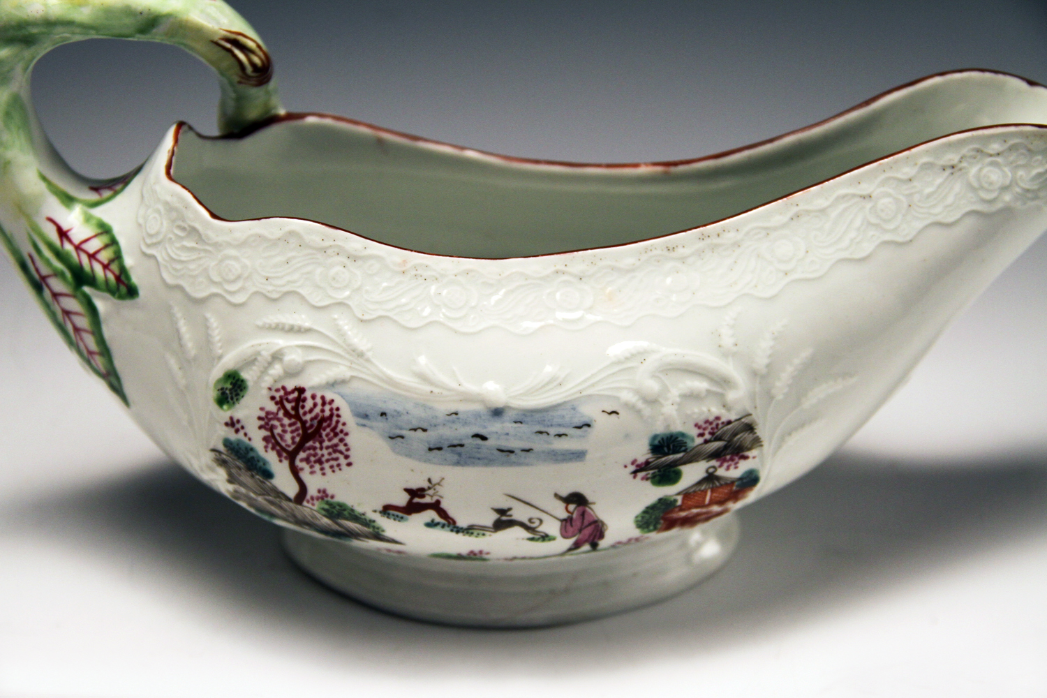 "1037 - Very rare Worcester polychrome sauceboat with the ""staghunt pattern"" c 1755"